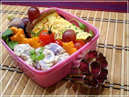 , carrot flowers and purple potato salad (the potatoes are purple ...